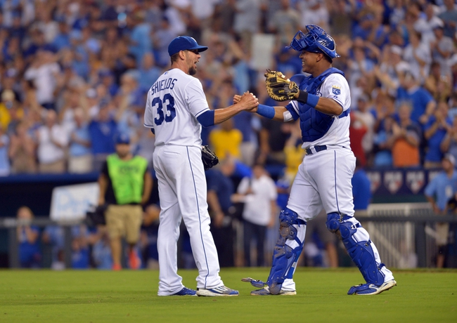 Aug 9, 2014; Kansas City, MO, USA; Kansas City Royals starting pitcher James Shields (33) is congratulated by catcher Salvador Perez (13) after pitching a complete game shutout against the San Francisco Giants at Kauffman Stadium. The Royals won 5-0. Mandatory Credit: Denny Medley-USA TODAY Sports
