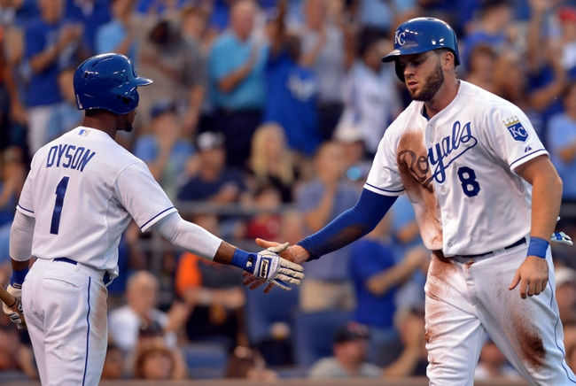 Aug 9, 2014; Kansas City, MO, USA; Kansas City Royals third baseman Mike Moustakas (8) is congratulated by center fielder Jarrod Dyson (1) after scoring in the seventh inning against the San Francisco Giants at Kauffman Stadium. The Royals won 5-0. Mandatory Credit: Denny Medley-USA TODAY Sports