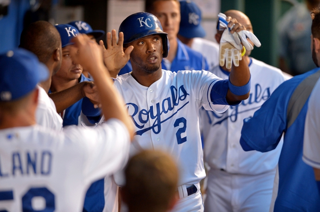 Aug 9, 2014; Kansas City, MO, USA; Kansas City Royals shortstop Alcides Escobar (2) is congratulated by teammates after scoring in the seventh inning against the San Francisco Giants at Kauffman Stadium. The Royals won 5-0. Mandatory Credit: Denny Medley-USA TODAY Sports