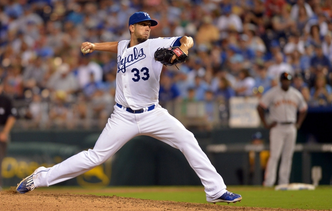 Aug 9, 2014; Kansas City, MO, USA; Kansas City Royals starting pitcher James Shields (33) delivers a pitch in the ninth inning against the San Francisco Giants at Kauffman Stadium. The Royals won 5-0. Mandatory Credit: Denny Medley-USA TODAY Sports