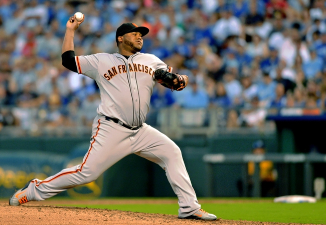 Aug 9, 2014; Kansas City, MO, USA; San Francisco Giants relief pitcher Jean Machi (63) delivers a pitch in the seventh inning against the Kansas City Royals at Kauffman Stadium. The Royals won 5-0. Mandatory Credit: Denny Medley-USA TODAY Sports