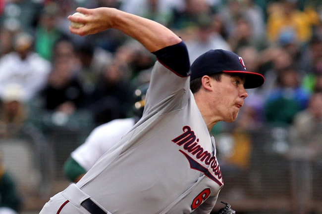 Aug 9, 2014; Oakland, CA, USA; Minnesota Twins starting pitcher Trevor May (65) throws to the Oakland Athletics in the first inning of their MLB baseball game at O.co Coliseum. Mandatory Credit: Lance Iversen-USA TODAY Sports