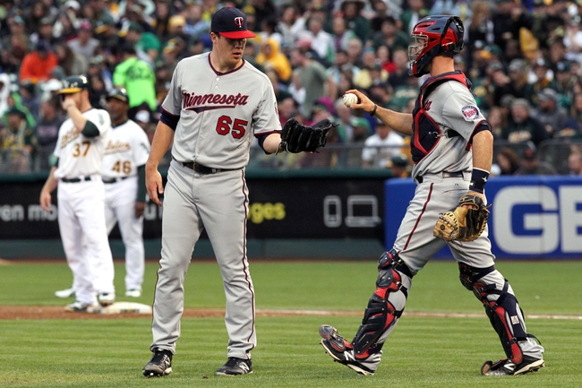 Aug 9, 2014; Oakland, CA, USA; Minnesota Twins catcher Eric Fryer (26) right talks with starting pitcher Trevor May (65) in the second inning of their MLB baseball game with the Oakland Athletics at O.co Coliseum. Mandatory Credit: Lance Iversen-USA TODAY Sports