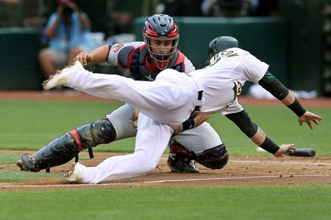 Aug 9, 2014; Oakland, CA, USA; Minnesota Twins catcher Eric Fryer (26) tags out  Oakland Athletics third baseman Josh Donaldson (20) at home plate in the second inning of their MLB baseball game at O.co Coliseum. Mandatory Credit: Lance Iversen-USA TODAY Sports