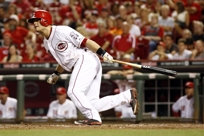 Aug 9, 2014; Cincinnati, OH, USA; Cincinnati Reds catcher Devin Mesoraco (39) hits a double off Miami Marlins relief pitcher Bryan Morris (not pictured) in the eighth inning at Great American Ball Park. The Marlins won 4-3. Mandatory Credit: David Kohl-USA TODAY Sports