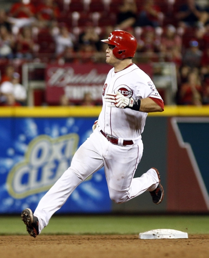 Aug 9, 2014; Cincinnati, OH, USA; Cincinnati Reds catcher Devin Mesoraco (39) stops at second base after hitting a double off Miami Marlins relief pitcher Bryan Morris (not pictured) in the eighth inning at Great American Ball Park. The Marlins won 4-3. Mandatory Credit: David Kohl-USA TODAY Sports