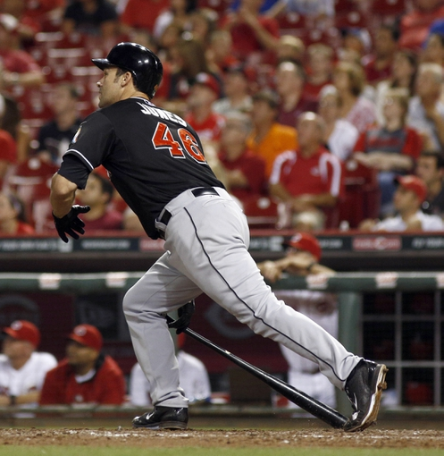Aug 9, 2014; Cincinnati, OH, USA; Miami Marlins first baseman Garrett Jones (46) hits a double in the ninth inning against the Cincinnati Reds at Great American Ball Park. The Marlins won 4-3. Mandatory Credit: David Kohl-USA TODAY Sports