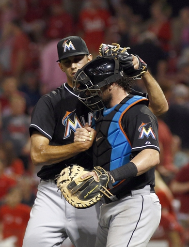 Aug 9, 2014; Cincinnati, OH, USA; Miami Marlins relief pitcher Steve Cishek (31) is congratulated by catcher Jarrod Saltalamacchia (39) after the Marlins defeated the Cincinnati Reds 4-3 at Great American Ball Park. Mandatory Credit: David Kohl-USA TODAY Sports