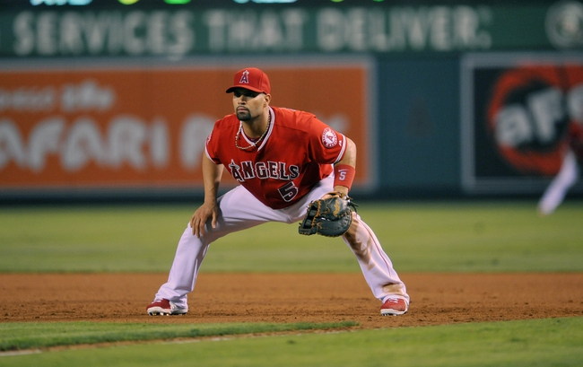 August 9, 2014; Anaheim, CA, USA; Los Angeles Angels first baseman Albert Pujols (5) defends in the seventh inning against the Boston Red Sox at Angel Stadium of Anaheim. Mandatory Credit: Gary A. Vasquez-USA TODAY Sports
