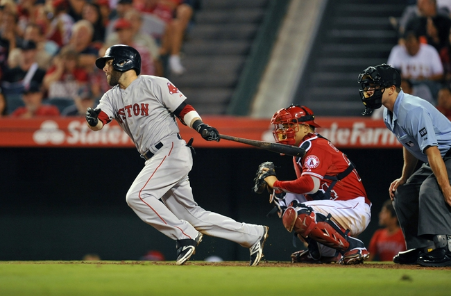August 9, 2014; Anaheim, CA, USA; Boston Red Sox second baseman Dustin Pedroia (15) at bat in the eighth inning against the Los Angeles Angels at Angel Stadium of Anaheim. Mandatory Credit: Gary A. Vasquez-USA TODAY Sports