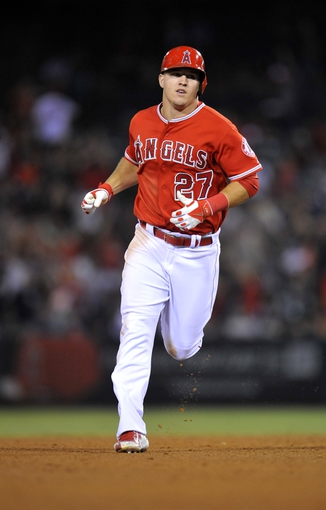 August 9, 2014; Anaheim, CA, USA; Los Angeles Angels designated hitter Mike Trout (27) rounds the bases after he hits a solo home run in the eighth inning against the Boston Red Sox at Angel Stadium of Anaheim. Mandatory Credit: Gary A. Vasquez-USA TODAY Sports