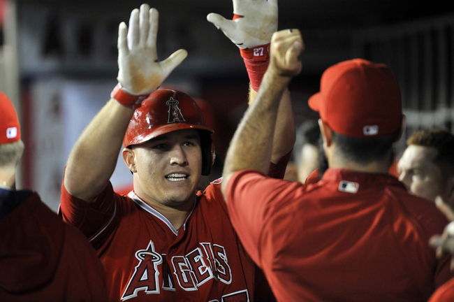 August 9, 2014; Anaheim, CA, USA; Los Angeles Angels designated hitter Mike Trout (27) celebrates after he hits a solo home run in the eighth inning against the Boston Red Sox at Angel Stadium of Anaheim. Mandatory Credit: Gary A. Vasquez-USA TODAY Sports