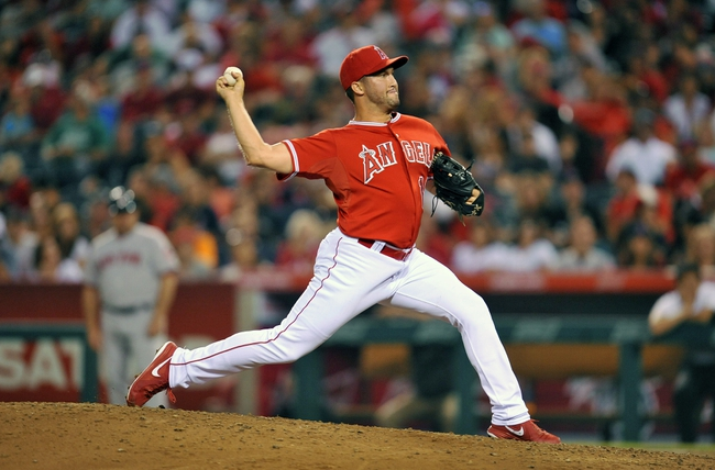 August 9, 2014; Anaheim, CA, USA; Los Angeles Angels relief pitcher Huston Street (16) pitches the ninth inning against the Boston Red Sox at Angel Stadium of Anaheim. Mandatory Credit: Gary A. Vasquez-USA TODAY Sports