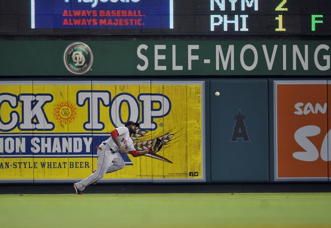 August 9, 2014; Anaheim, CA, USA; Boston Red Sox cente rfielder Jackie Bradley Jr. (25) makes a catch in the ninth inning against the Los Angeles Angels at Angel Stadium of Anaheim. Mandatory Credit: Gary A. Vasquez-USA TODAY Sports