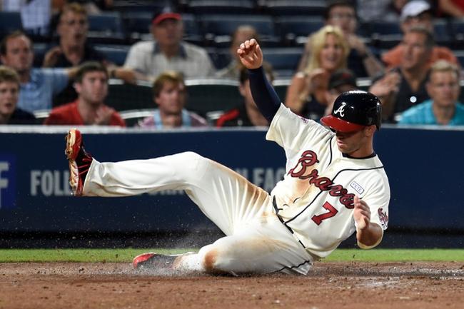Aug 9, 2014; Atlanta, GA, USA; Atlanta Braves second baseman Tommy La Stella (7) slides home with a run against the Washington Nationals during the sixth inning at Turner Field. Mandatory Credit: Dale Zanine-USA TODAY Sports