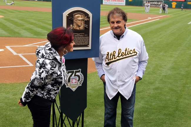 Aug 9, 2014; Oakland, CA, USA; Oakland Athletics former manager Tony La Russa is honored during a pre-game ceremony for his recent induction into the Baseball Hall of Fame prior to the A's game with the Minnesota Twins at O.co Coliseum. Attending with La Russa was his wife Elaine.  Mandatory Credit: Lance Iversen-USA TODAY Sports
