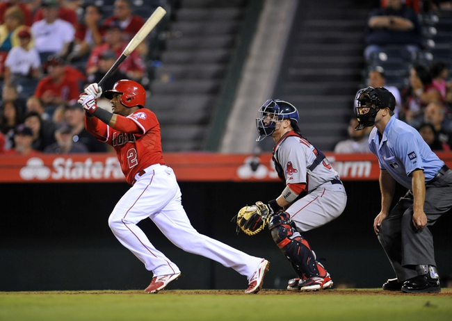 August 9, 2014; Anaheim, CA, USA; Los Angeles Angels shortstop Erick Aybar (2) hits a triple in the thirteenth inning against the Boston Red Sox at Angel Stadium of Anaheim. Mandatory Credit: Gary A. Vasquez-USA TODAY Sports