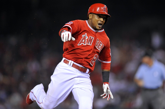 August 9, 2014; Anaheim, CA, USA; Los Angeles Angels shortstop Erick Aybar (2) runs to third after he hits a triple in the thirteenth inning against the Boston Red Sox at Angel Stadium of Anaheim. Mandatory Credit: Gary A. Vasquez-USA TODAY Sports
