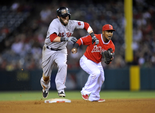 August 9, 2014; Anaheim, CA, USA; Boston Red Sox second baseman Dustin Pedroia (15) runs to third after stealing second in the fourteenth inning against the Los Angeles Angels at Angel Stadium of Anaheim. Mandatory Credit: Gary A. Vasquez-USA TODAY Sports