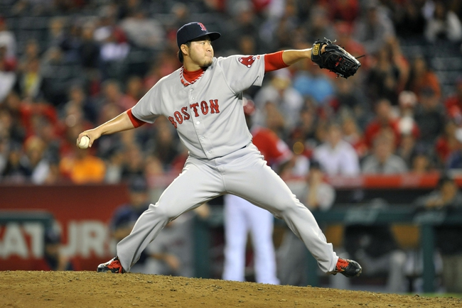 August 9, 2014; Anaheim, CA, USA; Boston Red Sox relief pitcher Junichi Tazawa (36) pitches the fourteenth inning against the Los Angeles Angels at Angel Stadium of Anaheim. Mandatory Credit: Gary A. Vasquez-USA TODAY Sports