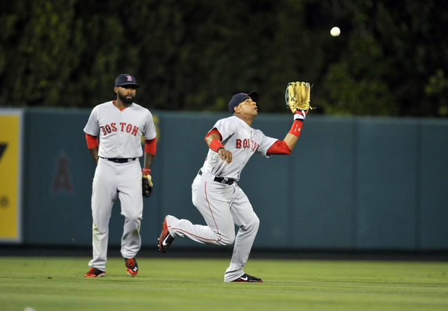 August 9, 2014; Anaheim, CA, USA; Boston Red Sox left fielder Yoenis Cespedes (52) catches a fly ball in the seventeenth inning against the Los Angeles Angels at Angel Stadium of Anaheim. Mandatory Credit: Gary A. Vasquez-USA TODAY Sports