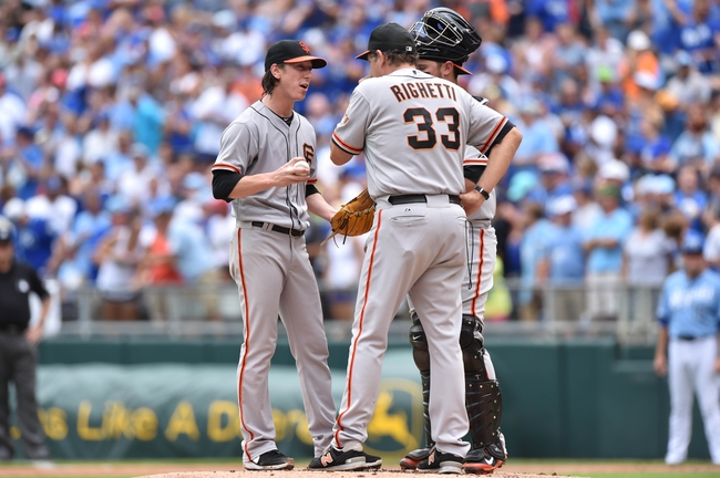 Aug 10, 2014; Kansas City, MO, USA; San Francisco Giants pitcher Tim Lincecum (55) talks with pitching coach Dave Righetti (33) against the Kansas City Royals during the first inning at Kauffman Stadium. Mandatory Credit: Peter G. Aiken-USA TODAY Sports