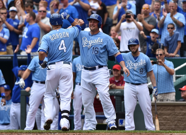 Aug 10, 2014; Kansas City, MO, USA; Kansas City Royals left fielder Alex Gordon (4) celebrates with teammate Billy Butler (16)  after hitting a two run home run against the San Francisco Giants during the first inning at Kauffman Stadium. Mandatory Credit: Peter G. Aiken-USA TODAY Sports