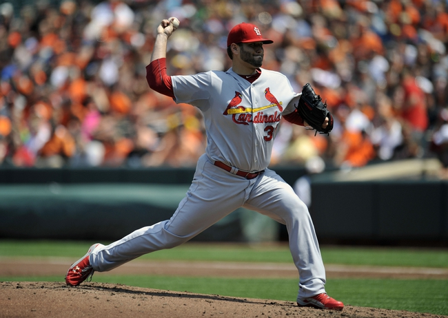 Aug 10, 2014; Baltimore, MD, USA; St. Louis Cardinals starting pitcher Lance Lynn (31) pitches in the first inning against the Baltimore Orioles at Oriole Park at Camden Yards. Mandatory Credit: Joy R. Absalon-USA TODAY Sports