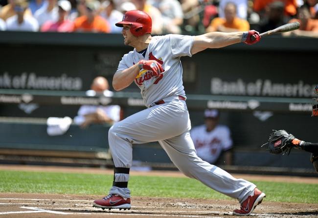 Aug 10, 2014; Baltimore, MD, USA; St. Louis Cardinals left fielder Matt Holliday (7) singles in the first inning against the Baltimore Orioles at Oriole Park at Camden Yards. Mandatory Credit: Joy R. Absalon-USA TODAY Sports