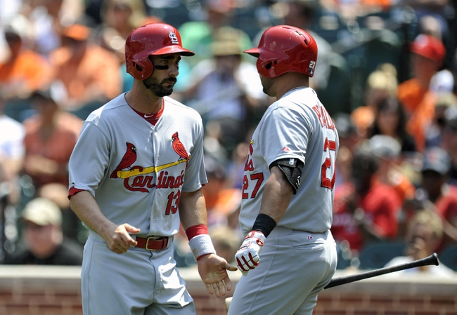 Aug 10, 2014; Baltimore, MD, USA; St. Louis Cardinals designated hitter Matt Carpenter (13) is congratulated by Jhonny Peralta (27) after scoring in the first inning against the Baltimore Orioles at Oriole Park at Camden Yards. Mandatory Credit: Joy R. Absalon-USA TODAY Sports