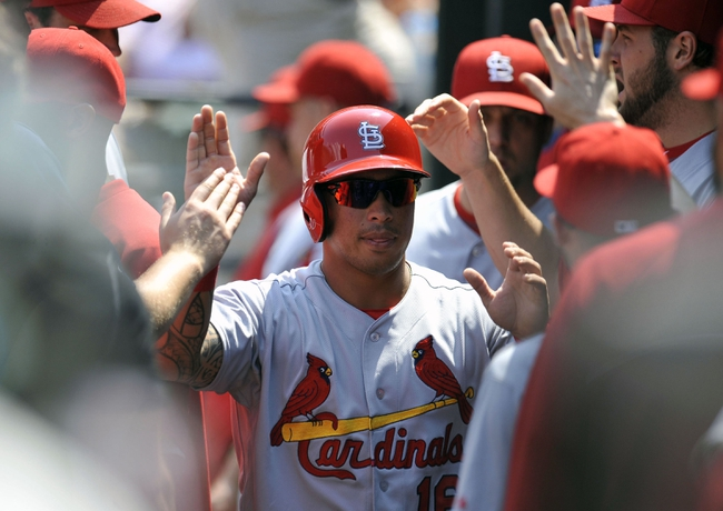 Aug 10, 2014; Baltimore, MD, USA; St. Louis Cardinals second baseman Kolten Wong (16) is congratulated by teammates after scoring in the first inning against the Baltimore Orioles at Oriole Park at Camden Yards. Mandatory Credit: Joy R. Absalon-USA TODAY Sports