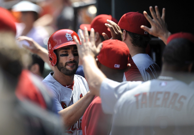 Aug 10, 2014; Baltimore, MD, USA; St. Louis Cardinals designated hitter Matt Carpenter (13) is congratulated by teammates after scoring in the first inning against the Baltimore Orioles at Oriole Park at Camden Yards. Mandatory Credit: Joy R. Absalon-USA TODAY Sports