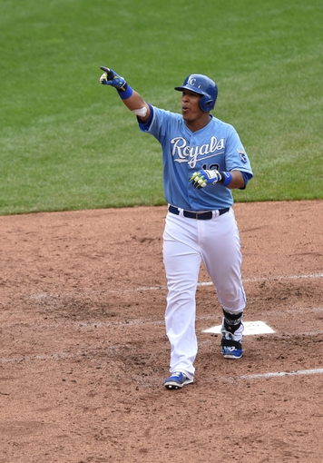 Aug 10, 2014; Kansas City, MO, USA; Kansas City Royals base runner Salvador Perez (13) reacts after hitting a three run home run against the San Francisco Giants during the fourth inning at Kauffman Stadium. Mandatory Credit: Peter G. Aiken-USA TODAY Sports