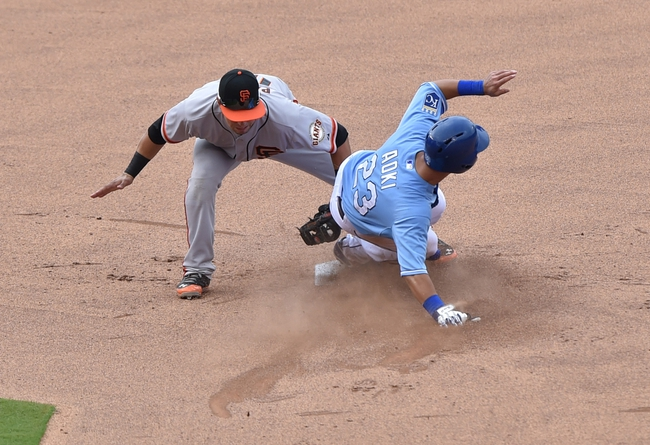 Aug 10, 2014; Kansas City, MO, USA; Kansas City Royals base runner Nori Aoki (32) slides into second with a stolen base against the San Francisco Giants second basemen Joe Pank (12)during the fourth inning at Kauffman Stadium. Mandatory Credit: Peter G. Aiken-USA TODAY Sports