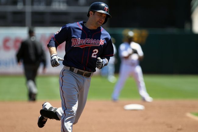 Aug 10, 2014; Oakland, CA, USA; Minnesota Twins second baseman Brian Dozier (2) rounds third base on his way home after hitting a solo home run against the Oakland Athletics in the first inning of their MLB baseball game at O.co Coliseum. Mandatory Credit: Lance Iversen-USA TODAY Sports