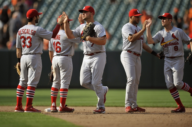 Aug 10, 2014; Baltimore, MD, USA; St. Louis Cardinals teammates celebrate after a game against the Baltimore Orioles at Oriole Park at Camden Yards. The Cardinals defeated the Orioles 8-3. Mandatory Credit: Joy R. Absalon-USA TODAY Sports