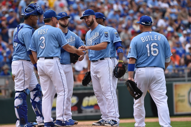 Aug 10, 2014; Kansas City, MO, USA; Kansas City Royals manager Ned Yost (3) takes pitcher Danny Duffy (41) out of the game against the San Francisco Giants during the seventh inning at Kauffman Stadium. Kansas City defeated San Francisco 7-4. Mandatory Credit: Peter G. Aiken-USA TODAY Sports