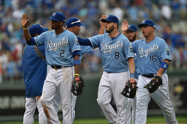 Aug 10, 2014; Kansas City, MO, USA; The Kansas City Royals celebrate after sweeping the three game series against the San Francisco Giants with a 7-4 win at Kauffman Stadium. Mandatory Credit: Peter G. Aiken-USA TODAY Sports