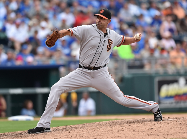 Aug 10, 2014; Kansas City, MO, USA; San Francisco Giants pitcher Jeremy Affeldt (41) delivers a pitch against the Kansas City Royals during the seventh inning at Kauffman Stadium. Kansas City defeated San Francisco 7-4. Mandatory Credit: Peter G. Aiken-USA TODAY Sports