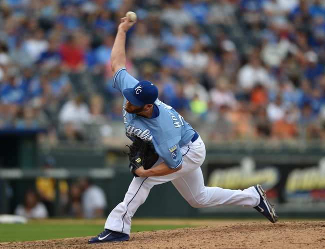 Aug 10, 2014; Kansas City, MO, USA; Kansas City Royals pitcher Gregg Holland (56) delivers a pitch against the San Francisco Giants during the ninth inning at Kauffman Stadium. Kansas City defeated San Francisco 7-4. Mandatory Credit: Peter G. Aiken-USA TODAY Sports