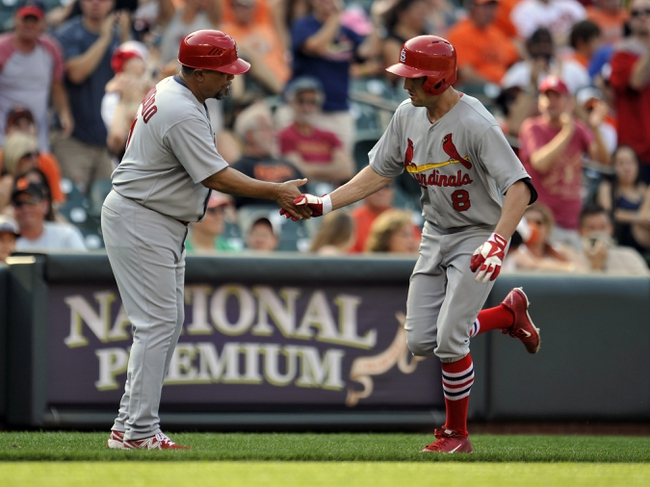 Aug 10, 2014; Baltimore, MD, USA; St. Louis Cardinals center fielder Peter Bourjos (8) is congratulate by third base coach Jose Oquendo (11) after hitting a three-run home run in the ninth inning against the Baltimore Orioles at Oriole Park at Camden Yards. The Cardinals defeated the Orioles 8-3. Mandatory Credit: Joy R. Absalon-USA TODAY Sports