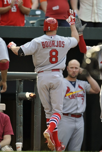Aug 10, 2014; Baltimore, MD, USA; St. Louis Cardinals center fielder Peter Bourjos (8 is congratulated by teammates after hitting a three-run home run in the ninth inning against the Baltimore Orioles at Oriole Park at Camden Yards. The Cardinals defeated the Orioles 8-3. Mandatory Credit: Joy R. Absalon-USA TODAY Sports