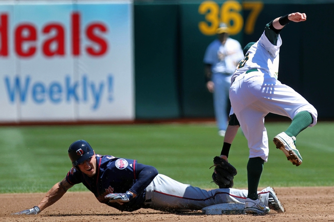 Aug 10, 2014; Oakland, CA, USA; Minnesota Twins left fielder Jordan Schafer (1) safely steals second base in front of Oakland Athletics shortstop Eric Sogard (28) at O.co Coliseum. Twins won 6-1. Mandatory Credit: Lance Iversen-USA TODAY Sports.