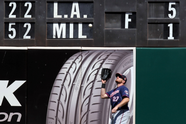 Aug 10, 2014; Oakland, CA, USA; Minnesota Twins right fielder Chris Parmelee (27) catches Oakland Athletics shortstop Eric Sogard (not pictured) deep fly ball in the seventh inning at O.co Coliseum. Twins won 6-1. Mandatory Credit: Lance Iversen-USA TODAY Sports.
