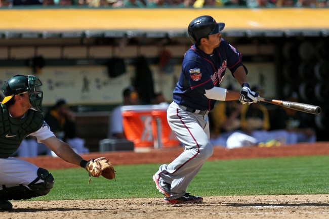 Aug 10, 2014; Oakland, CA, USA; Minnesota Twins catcher Kurt Suzuki (8) hits a RBI double in the eighth inning against the Oakland Athletics at O.co Coliseum. Mandatory Credit: Lance Iversen-USA TODAY Sports. Twins won 6-1.