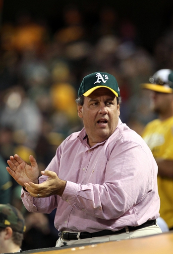 Aug 9, 2014; Oakland, CA, USA; (Editor's Note: Caption Correction) New Jersey governor Chris Christie applauds the Oakland Athletics at the end of their MLB baseball game with the Minnesota Twins at O.co Coliseum. Mandatory Credit: Lance Iversen-USA TODAY Sports.