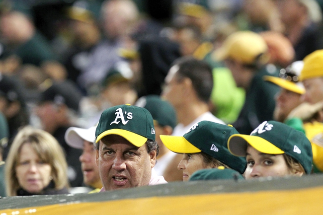 Aug 9, 2014; Oakland, CA, USA; (Editor's Note: Caption Correction) New Jersey governor Chris Christie sits with baseball fans behind the Oakland Athletics dugout during their MLB baseball game with the Minnesota Twins at O.co Coliseum. Mandatory Credit: Lance Iversen-USA TODAY Sports. A's won 9-4