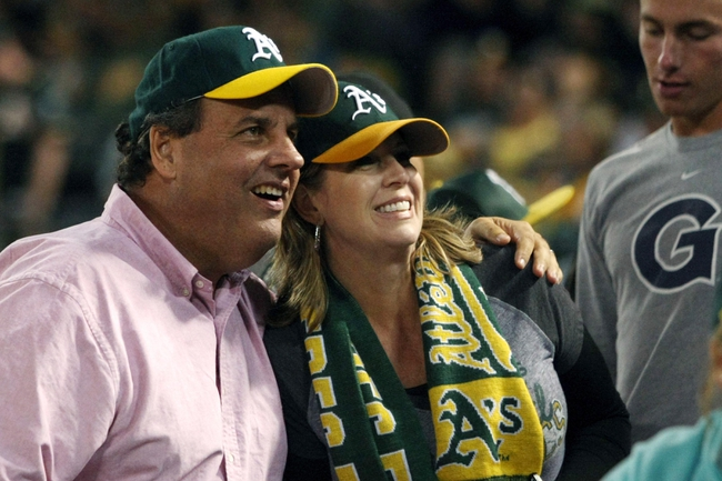 Aug 9, 2014; Oakland, CA, USA; (Editor's Note: Caption Correction) New Jersey governor Chris Christie poses for photos with baseball fans attending the game between the Oakland Athletics and Minnesota Twins at O.co Coliseum. Mandatory Credit: Lance Iversen-USA TODAY Sports. A's won 9-4