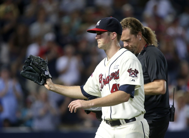 Aug 10, 2014; Atlanta, GA, USA; Atlanta Braves starting pitcher Alex Wood (40) reacts to the fans cheers after leaving the game in the eighth inning of their game against the Washington Nationals at Turner Field. The Braves won 3-1. Mandatory Credit: Jason Getz-USA TODAY Sports