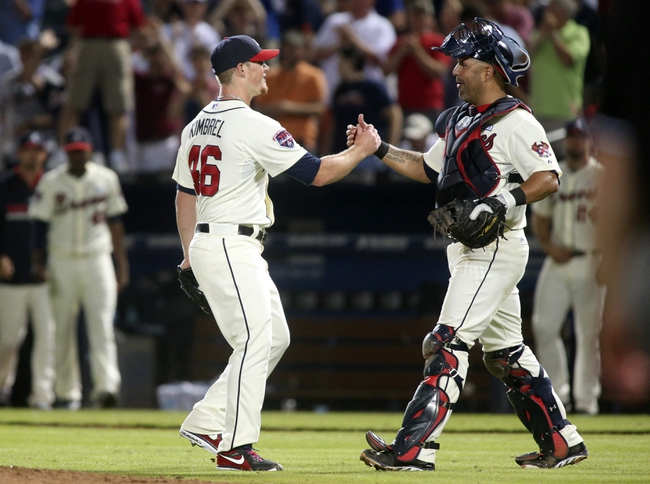 Aug 10, 2014; Atlanta, GA, USA; Atlanta Braves relief pitcher Craig Kimbrel (46) and catcher Gerald Laird (11) celebrate their win over the Washington Nationals at Turner Field. The Braves won 3-1. Mandatory Credit: Jason Getz-USA TODAY Sports